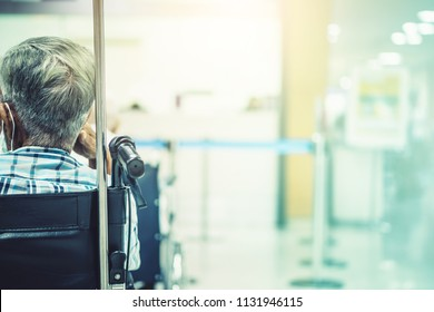 Blur hospital Background with patient on bed and wheelchair waiting in hallway. showing quality of healthcare service for illness old elder sick people with support from professional nurse and doctor