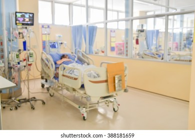 Blur ICU room in a hospital with medical equipments and patient.