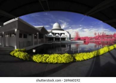 blur image of An-Nur Mosque Perak by the lakeside viewed in infrared
