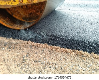 Blur image, asphalt paving With heavy machinery in Thailand