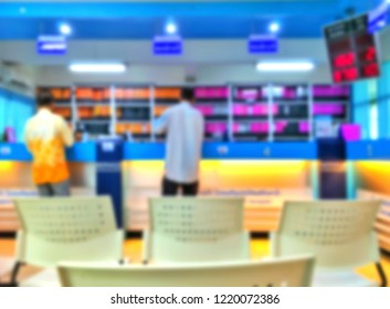 Blur image back side of 2 men are contacting financial transactions in front of bar counter of bank with digital queuing techniques program and empty chair on convenience service in business concept