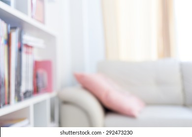 blur image background, book shelf and sofa furniture interior decoration in home