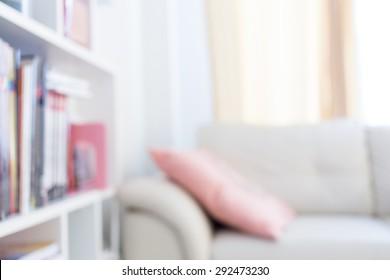 blur image background, book shelf and sofa furniture interior decoration in home