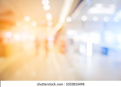 blur image background of hall in shopping mall with people