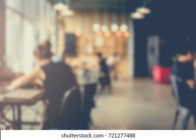 blur image background of office or co working space with people