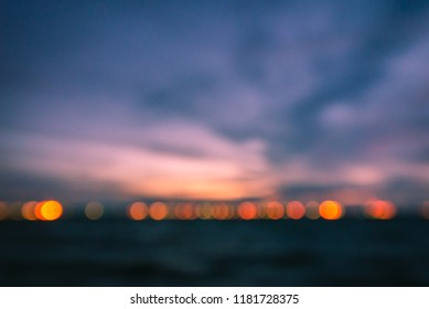 Blur image background of sunset sky and abstract light bokeh background on the beach.Background concept.