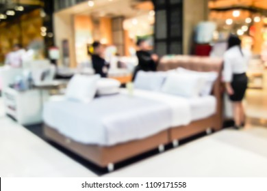 Blur image of bedding sales in the mall.