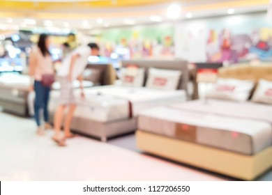 Blur image of bedding shop in the mall.