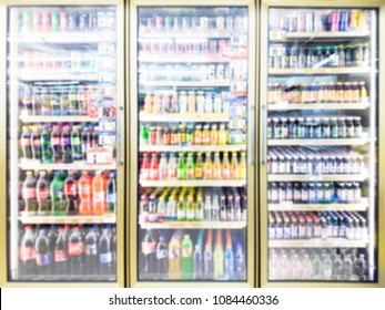 Blur image of beverage cooler in a convenience store.