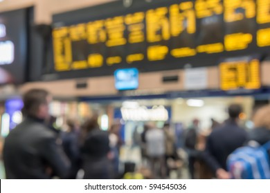 Blur image bokeh of People looking at Arrival departure board schedule at Euston Train Station in London, United Kingdom.