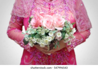 blur image of  bride holding a flower bouquet. wedding decoration isolated on white background