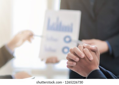 Blur image of a businessman in a meeting room.Group of business people who are attending the meeting to summarize their business performance to calculate annual income and profit