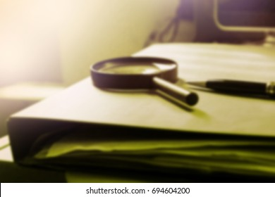 blur image of busy table of business worker