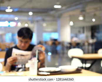 Blur image Canteen, Abstract blurred canteen, Blur image of asian man reading a book in canteen.