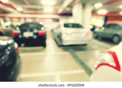 Blur image of car in parking lot.