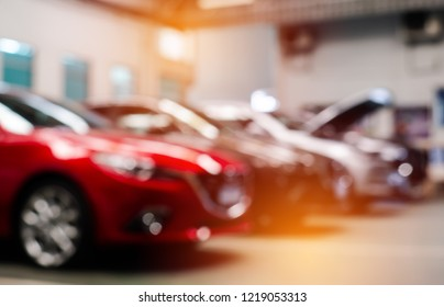 Blur image of car showroom background.