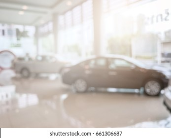 Blur image of car in the showroom use for background