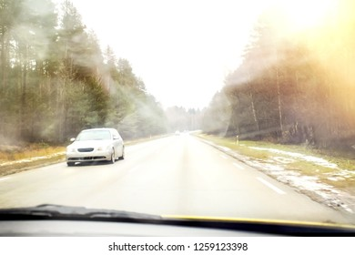 Blur image. Cars in the fog. Bad weather and dangerous automobile traffic on the road. Vehicles in mist. View on highway traffic in misty evening. Low visibility