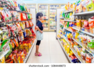 Blur image of children are buying snacks in a convenience store.