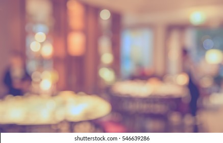 blur image of Chinese restaurant with bokeh for background usage . (vintage tone)