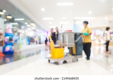 Blur image of cleaner working in department store.