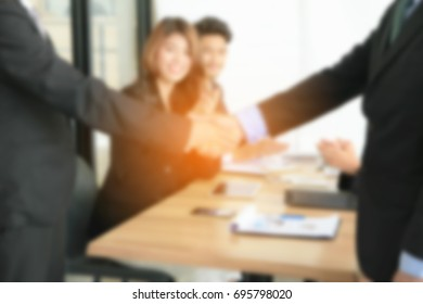 Blur image Close up of businessmen shaking hand in office,on meeting background