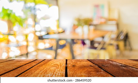 blur image of coffee shop with bokeh for bacground usage.