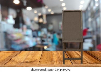 blur image of coffee shop with wooden tag label for text or write cofffee menu.