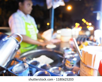 Blur image of cooking egg Roti over hot pan with palm oil in old style, cooking Roti in a black hot pan, Blurred background cooking Roti.