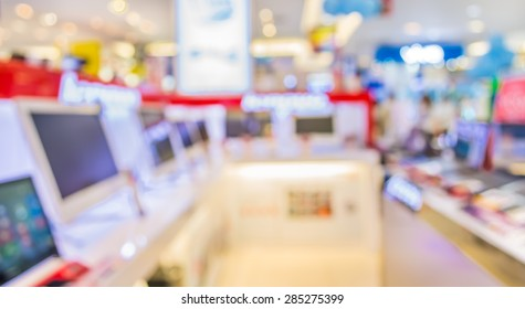 blur image of eletronic department store with bokeh for background usage .