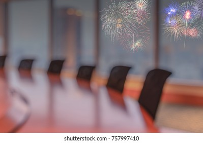 Blur image of empty boardroom with window cityscape and firworks background. Business concept