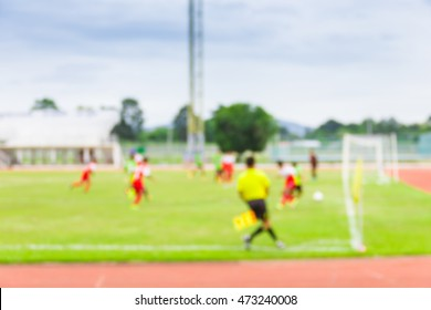 Blur image of football match at University, use for background.