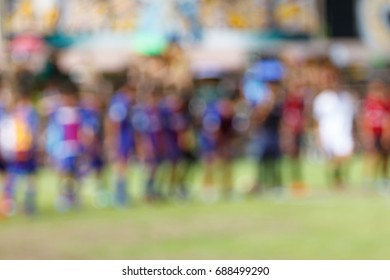 Blur image of football player In the field