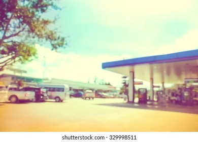 blur image of gas station in vintage tone