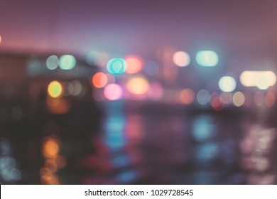 Blur image of Hong Kong night view with circle bokeh in vintage style