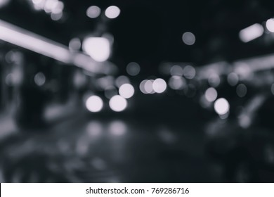Blur image of Hong Kong night view with circle bokeh, b&w color