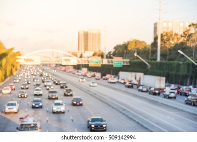 Blur image Interstate Highway 69 afternoon rush hour, downtown Houston, Texas, US. High-occupancy vehicle lane used at peak travel times.  Freeway trench with long-span arched bridge and street signs.