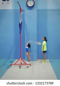 Blur image for kid academy of badminton in stadiam