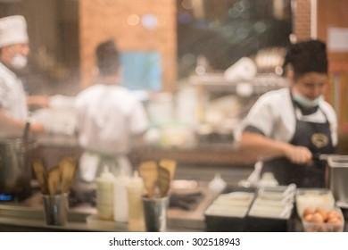 blur image of kitchen in restaurant