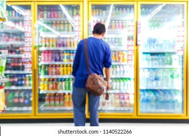 Blur image of laborers are looking for the drinks they need in beverage cooler.