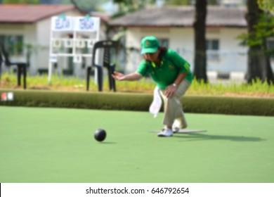 Blur image of ladies playing lawn ball.