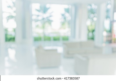 blur image of living room with table and sofa for background usage.