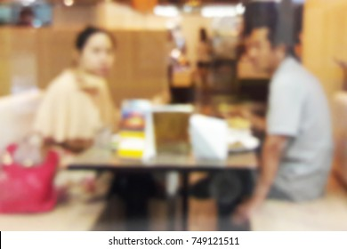 Blur image of Lovers have diner in the restaurant.