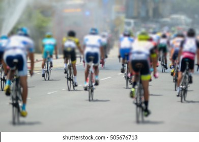 blur image of many cyclist on road circuit.Image is out focus and motion blur