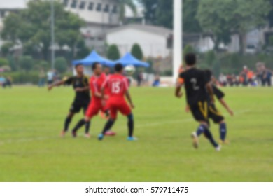 Blur image of mens playing football