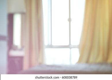 Blur image of modern bed room interior for background, Pastal light filter.