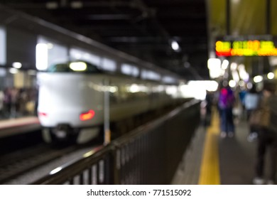 Blur image of passengers waiting train at metro station, use as background