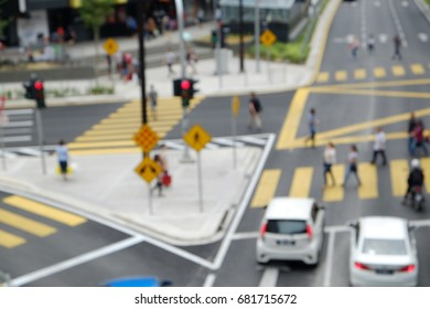 Blur image of pedestrians crossing a junction in Bukit Bintang, Kuala Lumpur.