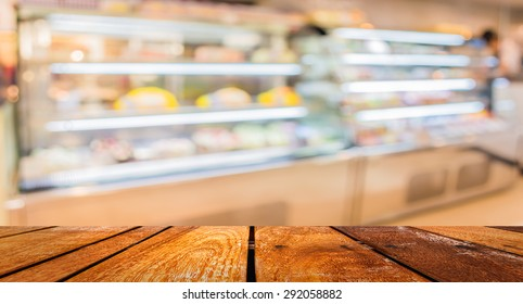 Blur image of people in bakery shop for background usage .