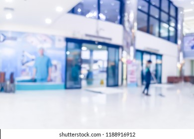 Blur image of people in clinic lobby hall at modern hospital